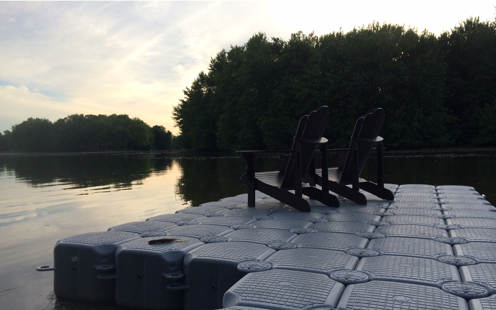 grey Jetfloat dock with Muskoka chairs